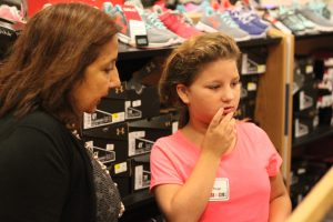 It can be tricky to pick the right shoes for a successful school year. It's a good thing it was a team effort!